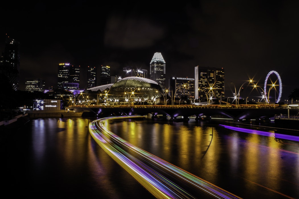 City skyline at night, with neon colours