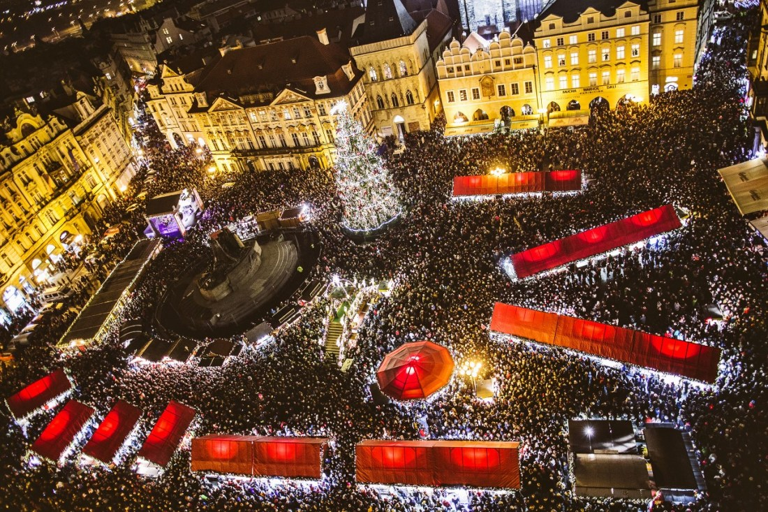 Aerial view of a crowded Christmas market at night