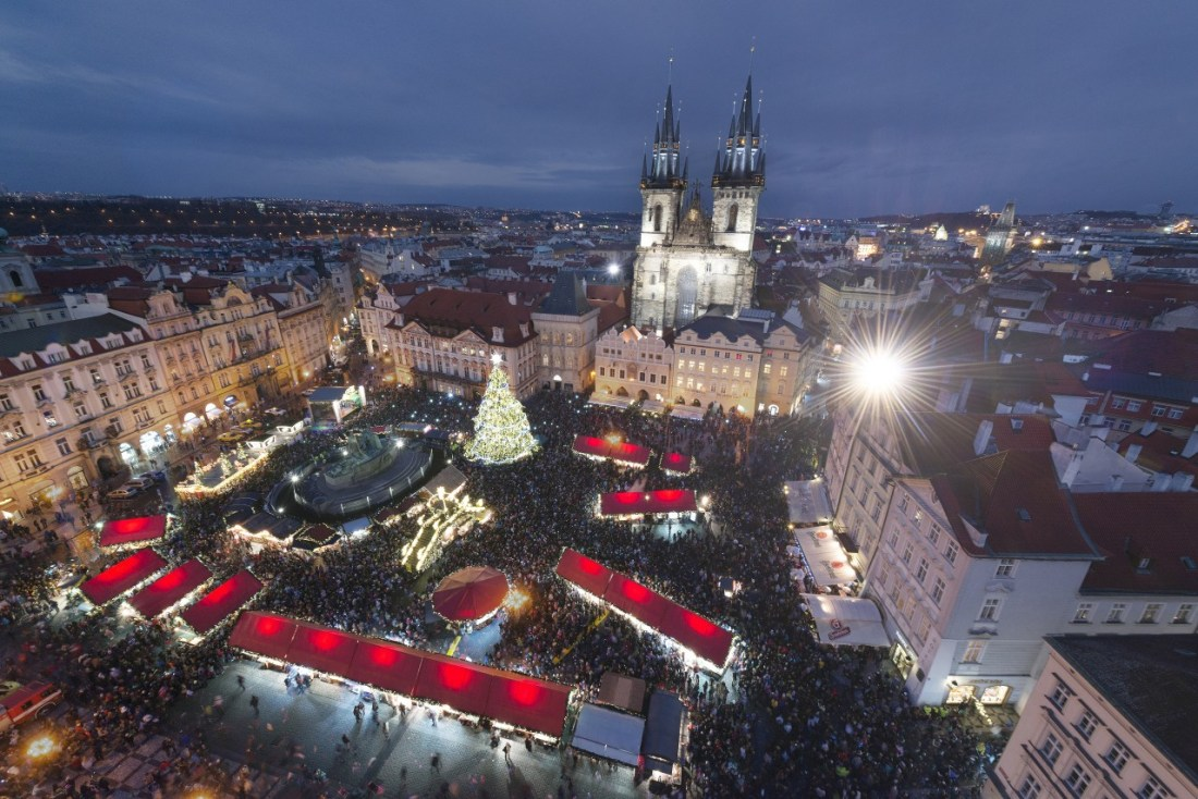 Aerial shot of crowds shopping in a Christmas market in Prague