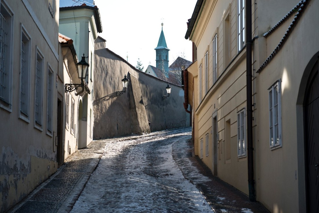 An empty uphill street in Prague