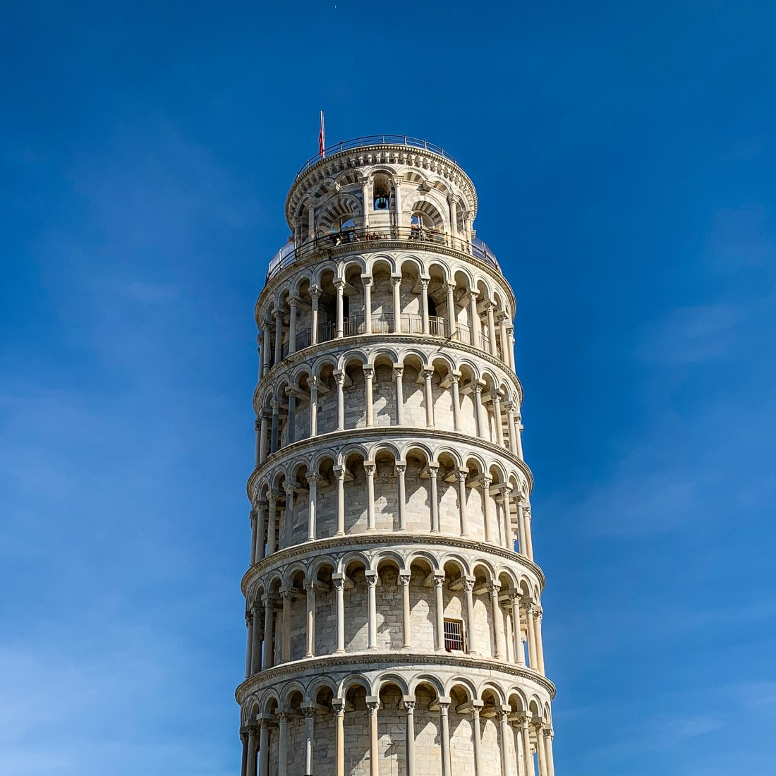 The Leaning Tower of Pisa against a blue sky