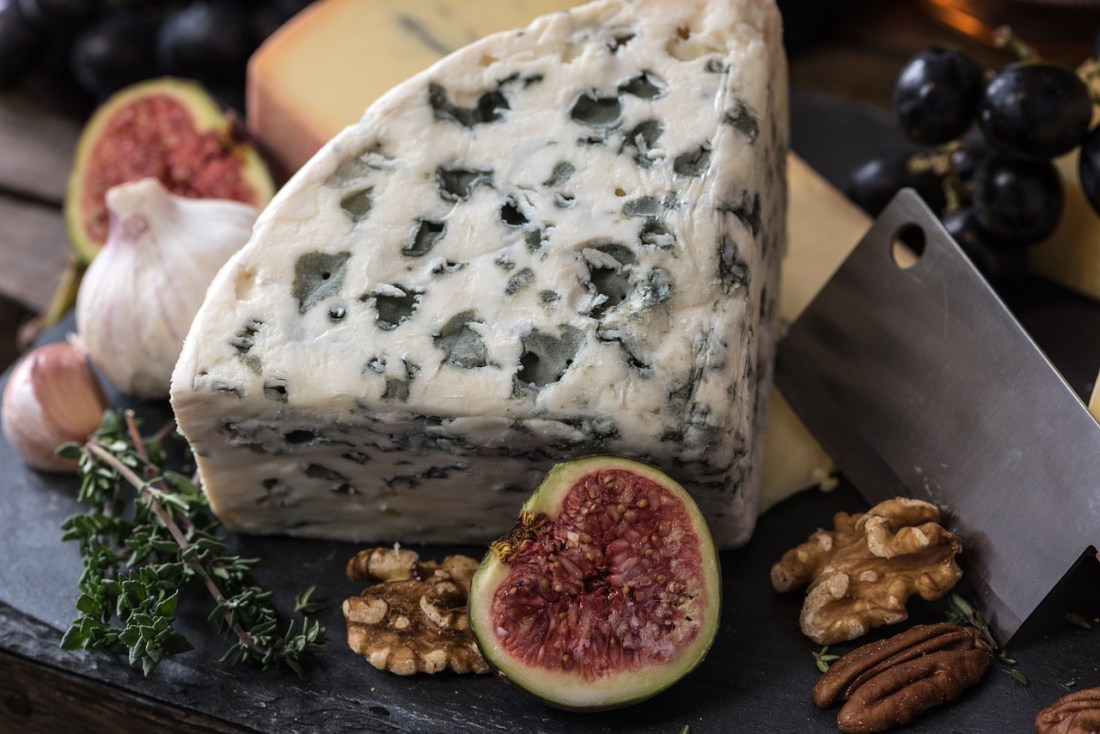 A plate of French cheese and figs - Food Anxiety When Traveling