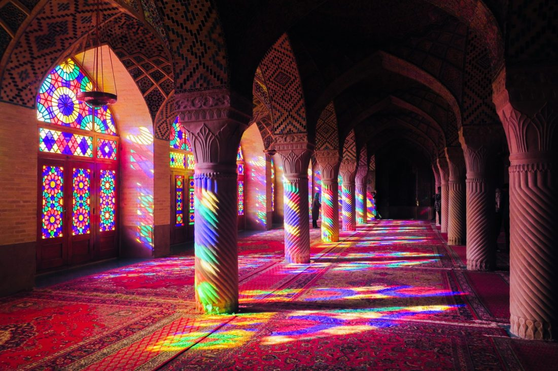 Stained glass windows create beautiful patterns on the floor of a mosque in Iran - How to Overcome Travel Anxiety - Travel Bloggers' Stories