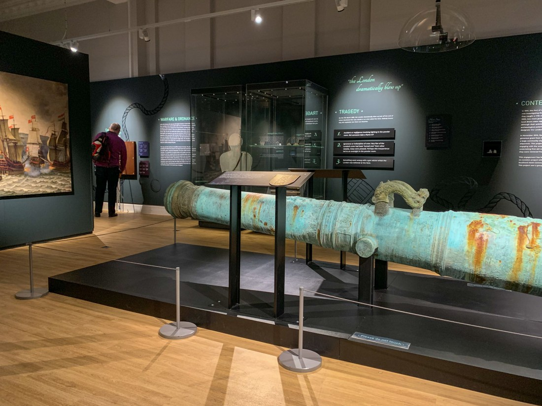 A large cannon in a shipwreck exhibition