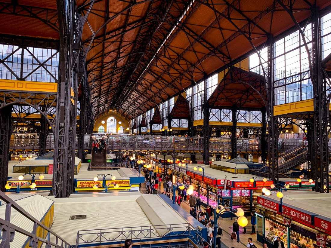 A busy market hall in Budapest with countless stalls selling food