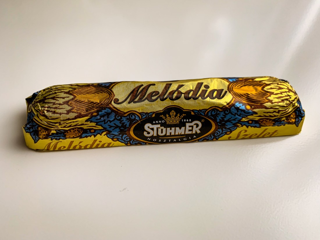 A bar of Stuhmer Melodia chocolate, wrapped in a gold and blue wrapper