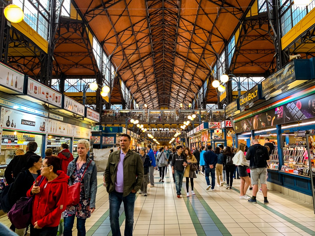 Shoppers walk through the aisles of the Central Market Hall, a useful place for souvenir shopping during 3 days in Budapest.