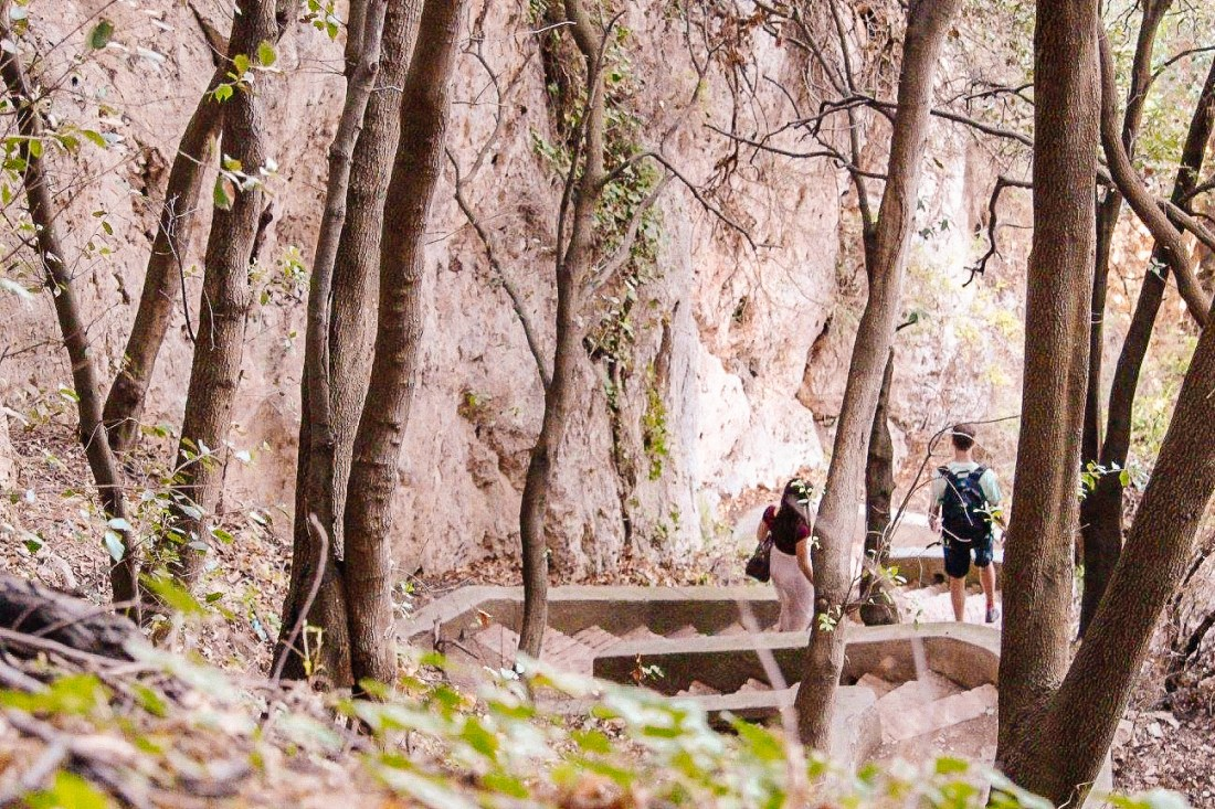 Walkers traversing a staircase and starting the scenic Via del Pizzolungo on Capri's southern coast