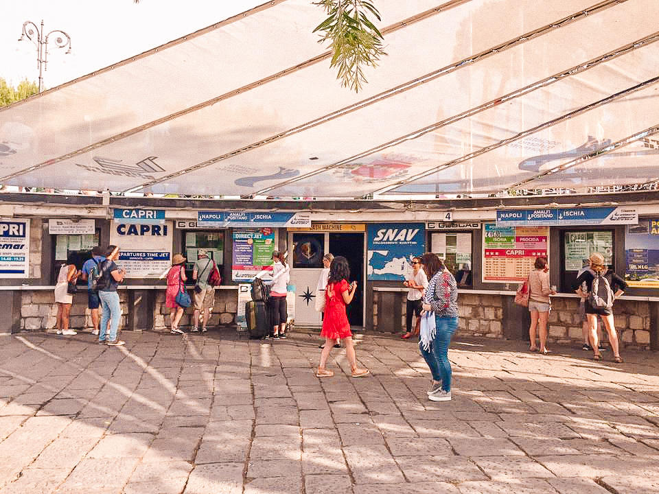 Sorrento ferry terminal, with booths advertising different locations. Buying tickets to Capri is possible here.