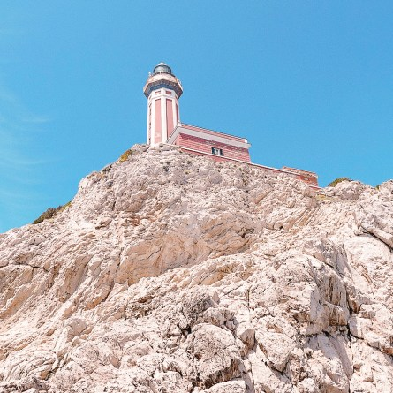 The Punta Carena lighthouse on Capri is pink, and sits on creamy rocks. A very pretty spot and a good place for wedding photography on Capri.