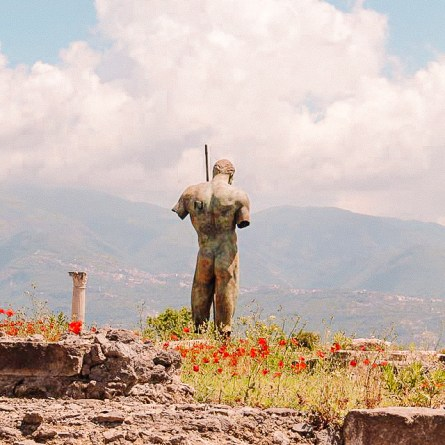 A statue outside of Pompeii looks down a hillside. One of the most instagrammable spots in Naples.