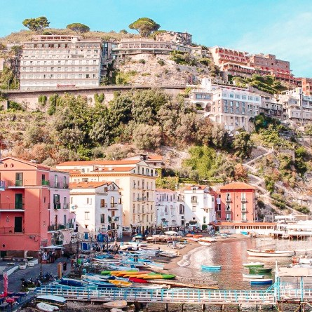 Sorrento's Marina Grande, with pastel-colored houses sitting around a harbor. Sorrento is one of the most instagrammable spots on the Amalfi Coast.