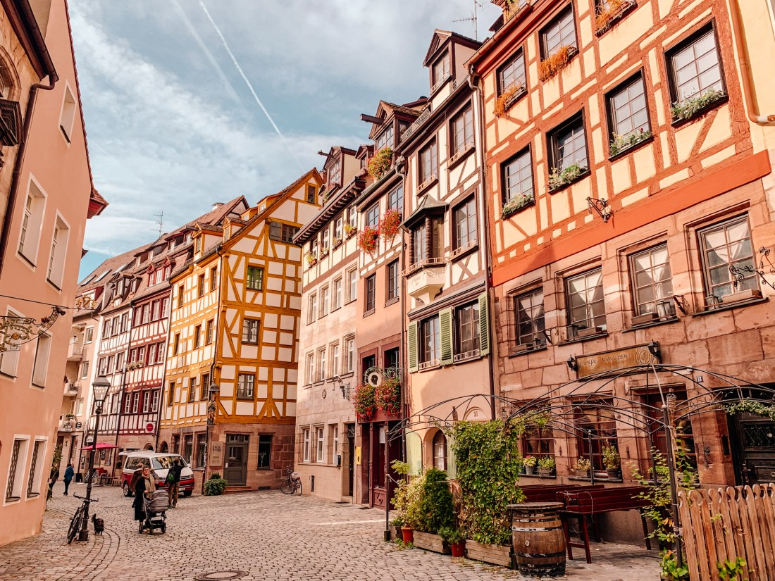 The pretty streets of Nuremberg in Germany, with wooden beams visible, and a blue sky overhead.