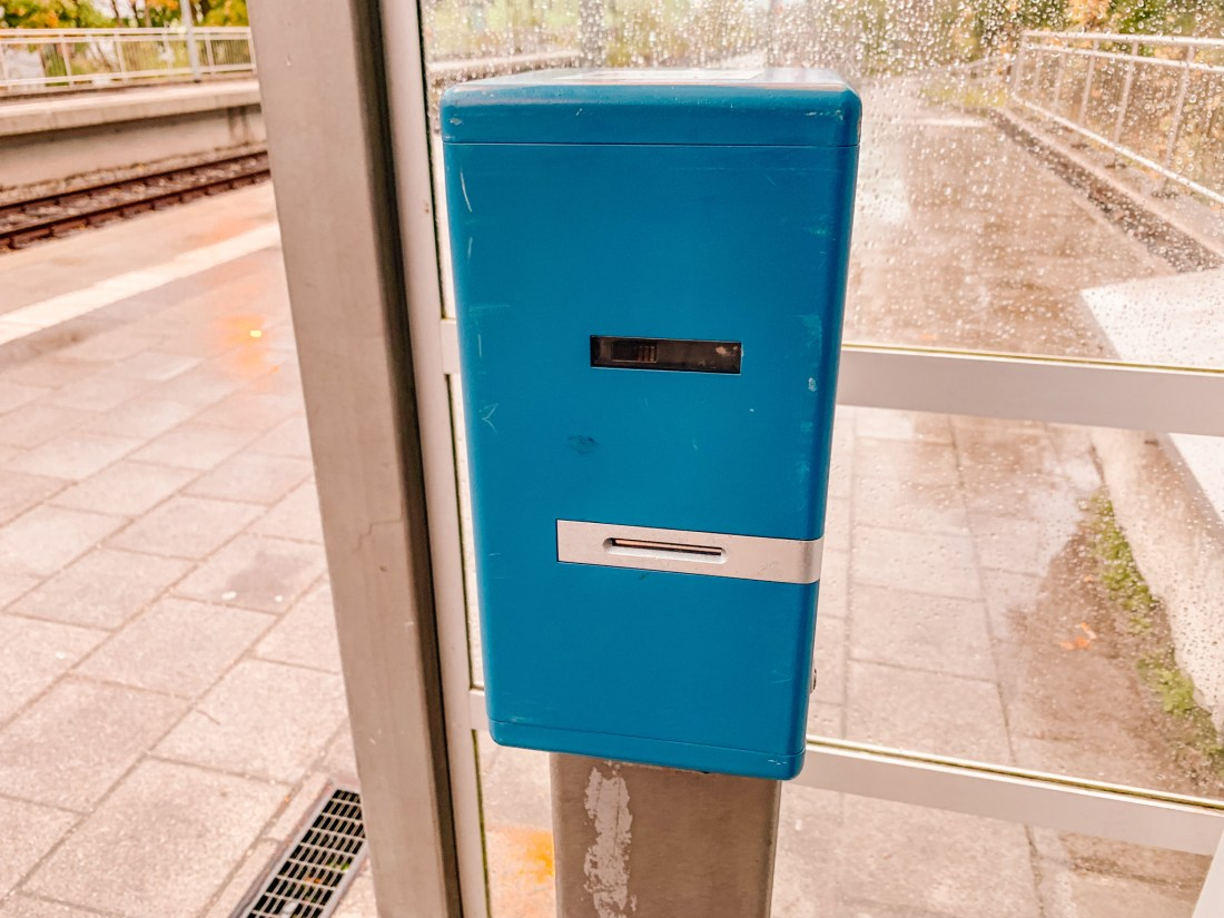 A validation machine on the platform of Munich Fasangarten station