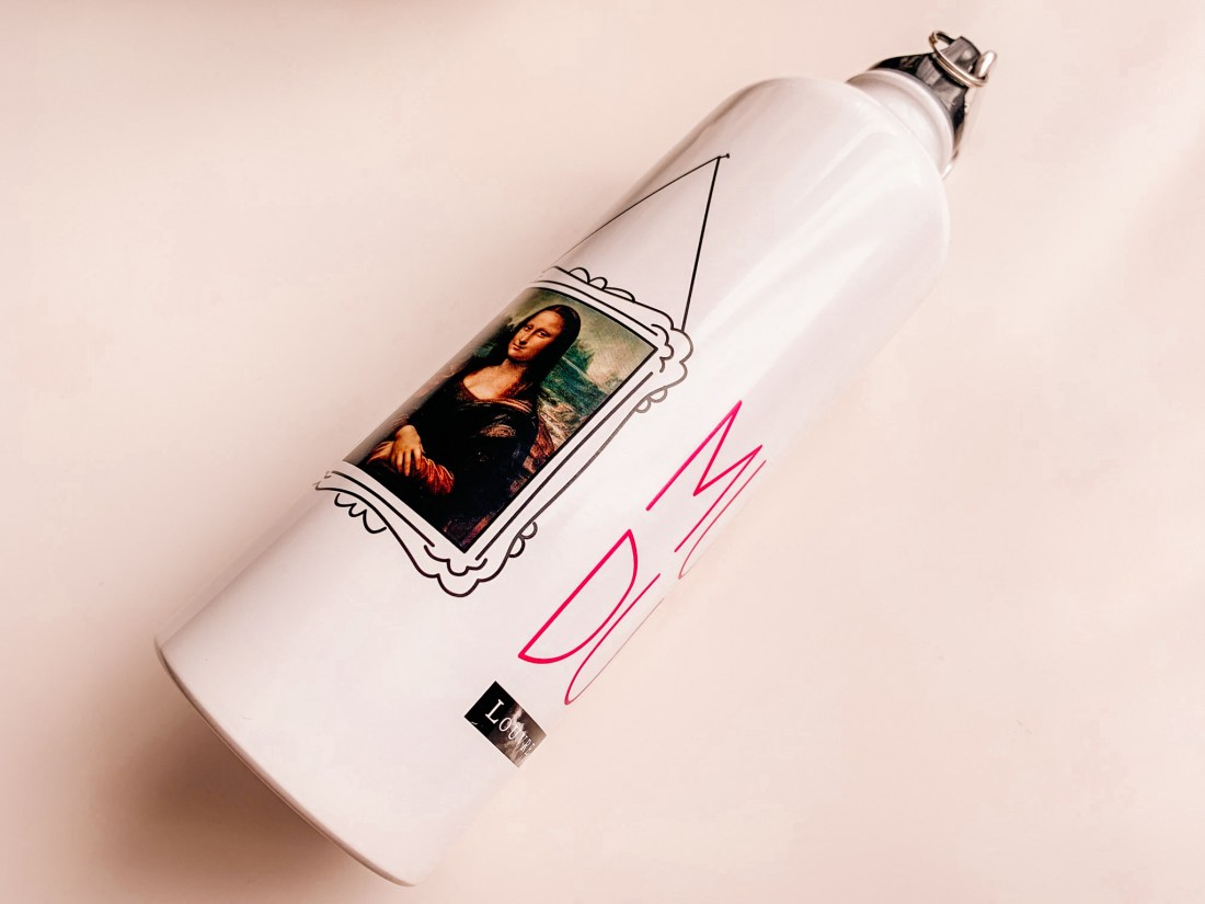 A metal water bottle from the Louvre Museum, featuring the Mona Lisa.