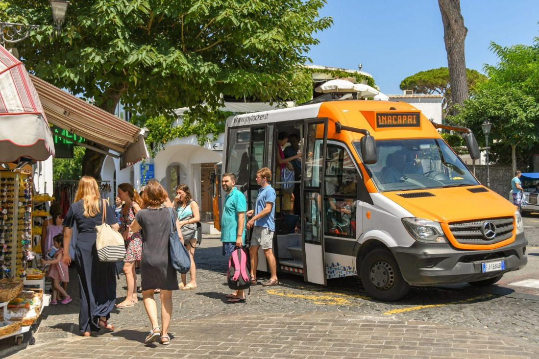 A bus to Anacapri in Capri, allowing passengers to disembark.