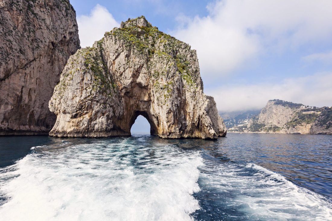A view of the Faraglioni rock of Mezzo, and the Love Arch.