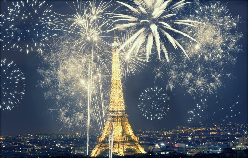 Fireworks exploding next to the Eiffel Tower in Paris