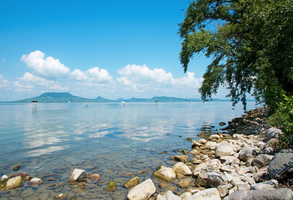 Lake Balaton in Hungary, with blue waters underneath a blue sky.