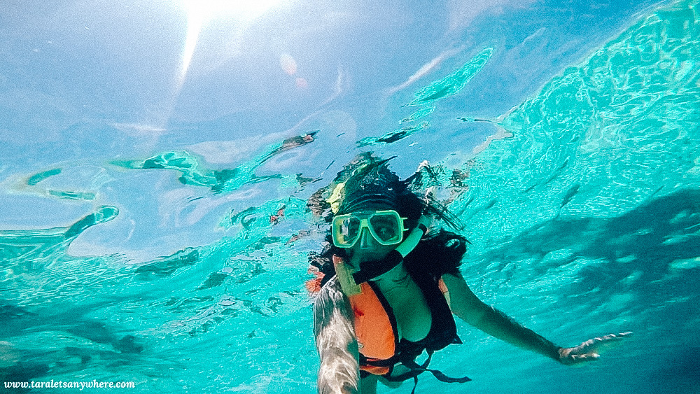 A woman snorkeling in the Perhentian Islands, a great destination for budget trips in Asia