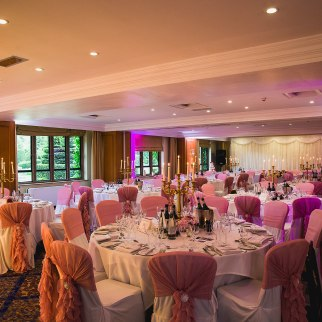 The main room set up from D&H wedding - real wedding inspiration - in a red, dusky pink and gold colour palette