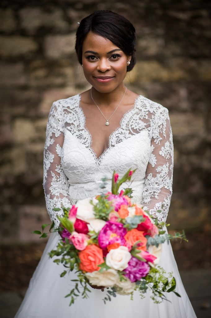 Bride with flowers real wedding inspiration