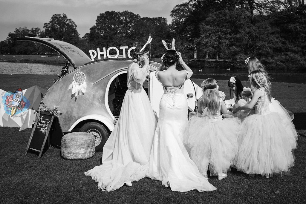 pixie the photobooth captured by kirsty rockett photography - group of children with couple in wedding dresses and bunny ears waiting to be photographed