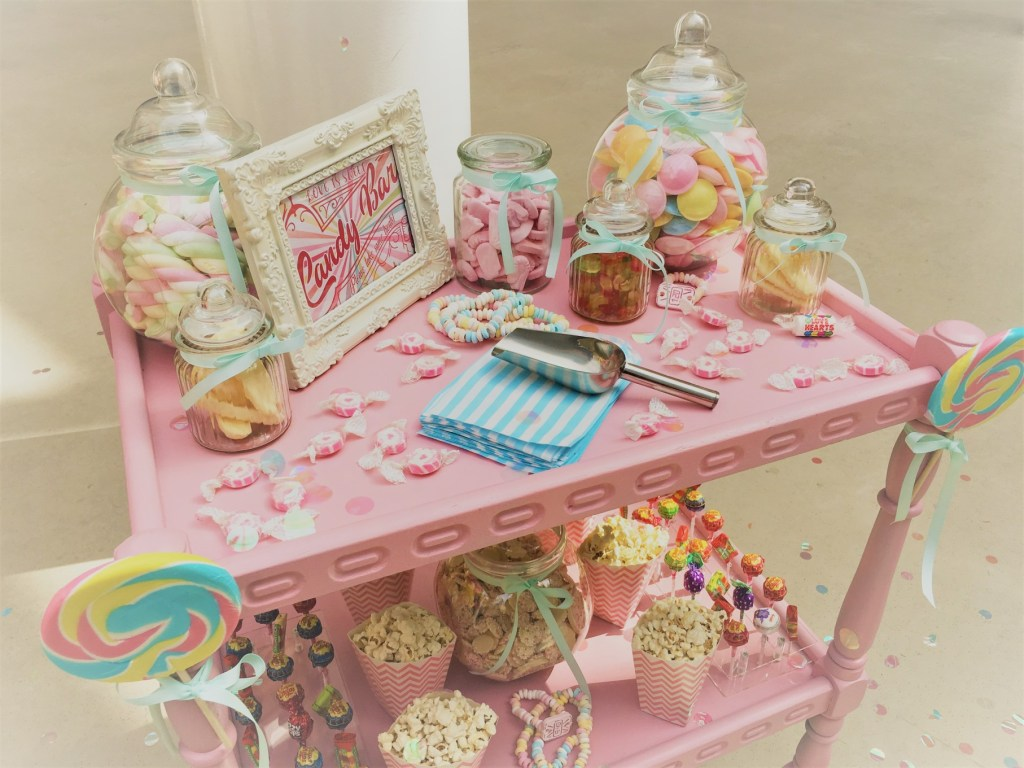wedding styling - alternative wedding - pink sweetie trolley - candy bar
