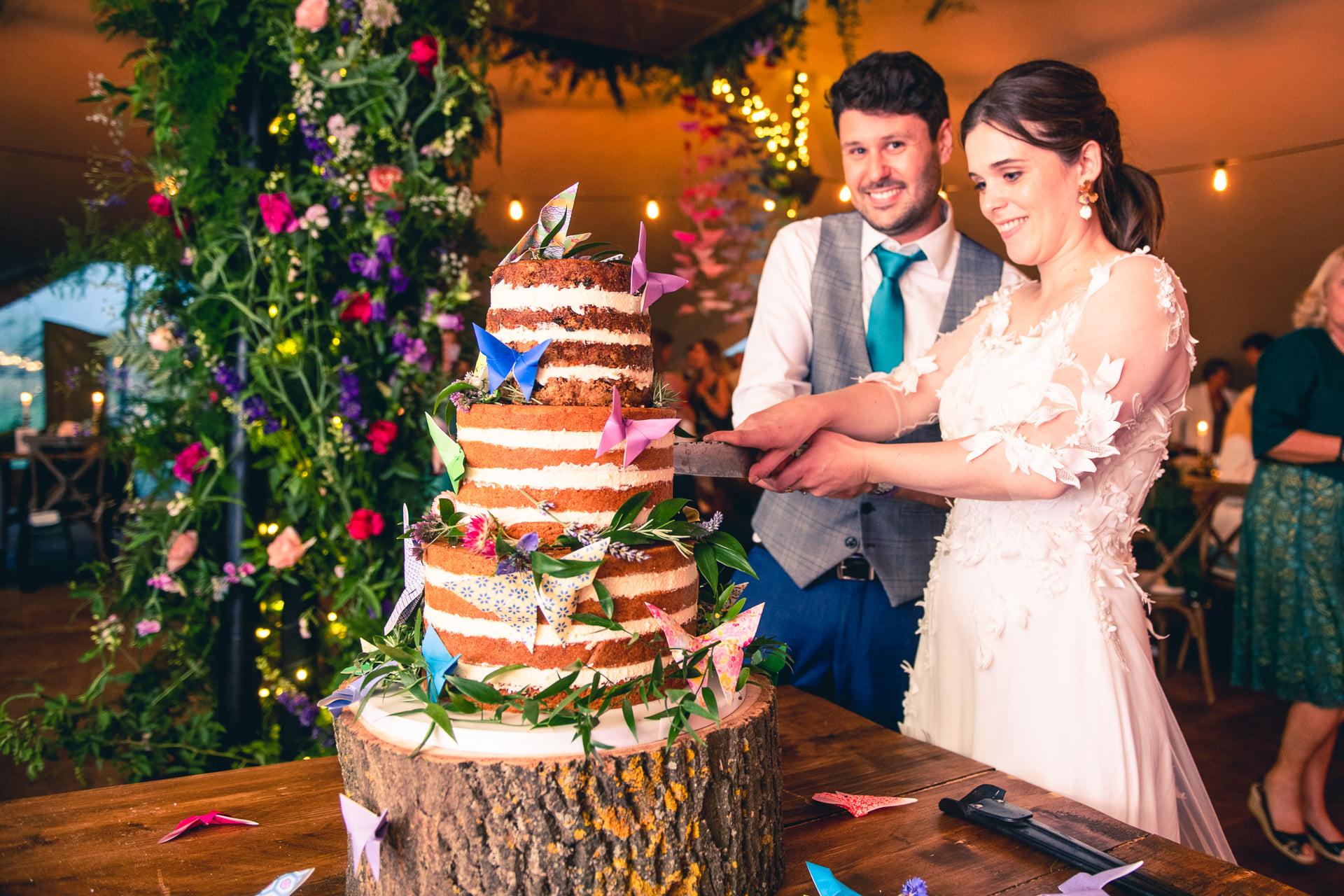 oaktree farm weddings - nottingham outdoor wedding venue - field wedding - marquee wedding 1- cutting the wedding cake