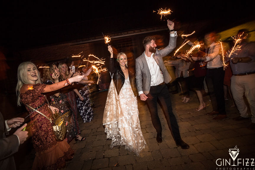 B&N barn wedding day at castle view farm & stables- bride & groom with sparklers - wedding guests holding sparklers either side