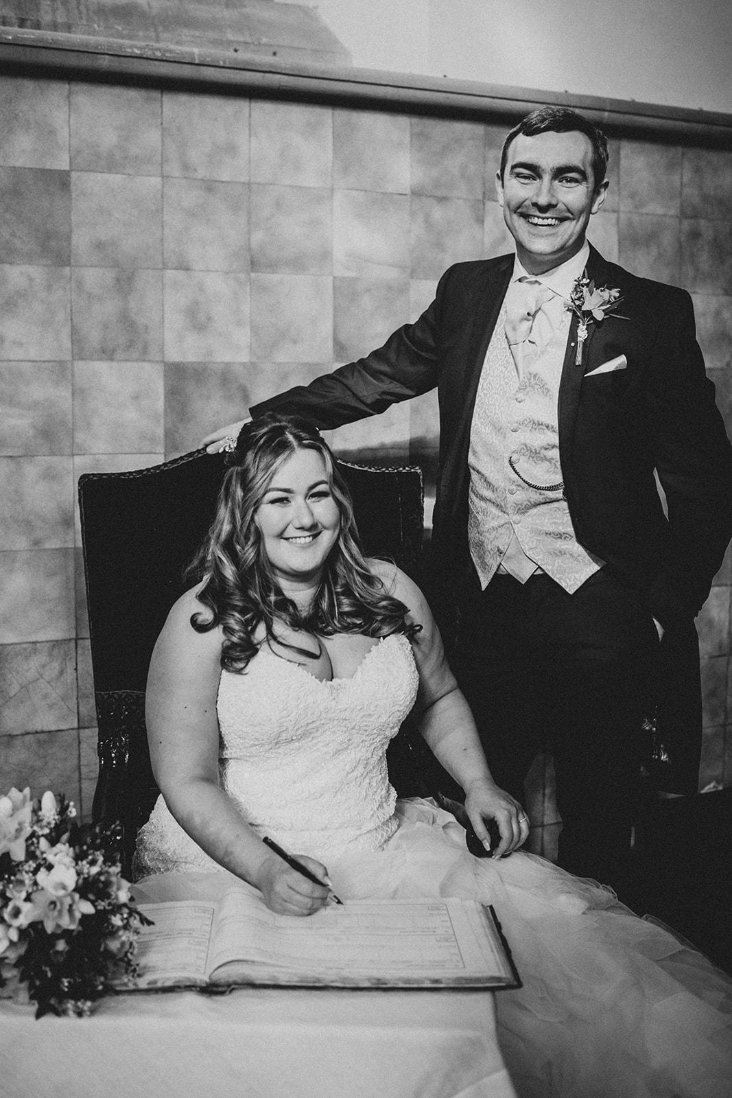 bride and groom signing register - rutland wedding - fun wedding - east midlands wedding planner - Leicestershire wedding planning - nottingham wedding planner