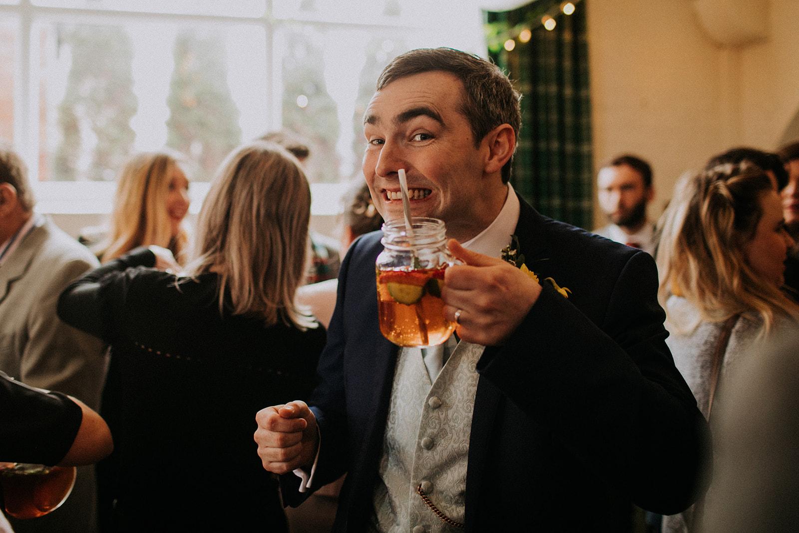 rutland wedding - fun wedding - east midlands wedding planner - Leicestershire wedding planning - nottingham wedding planning - groom drinking cocktail