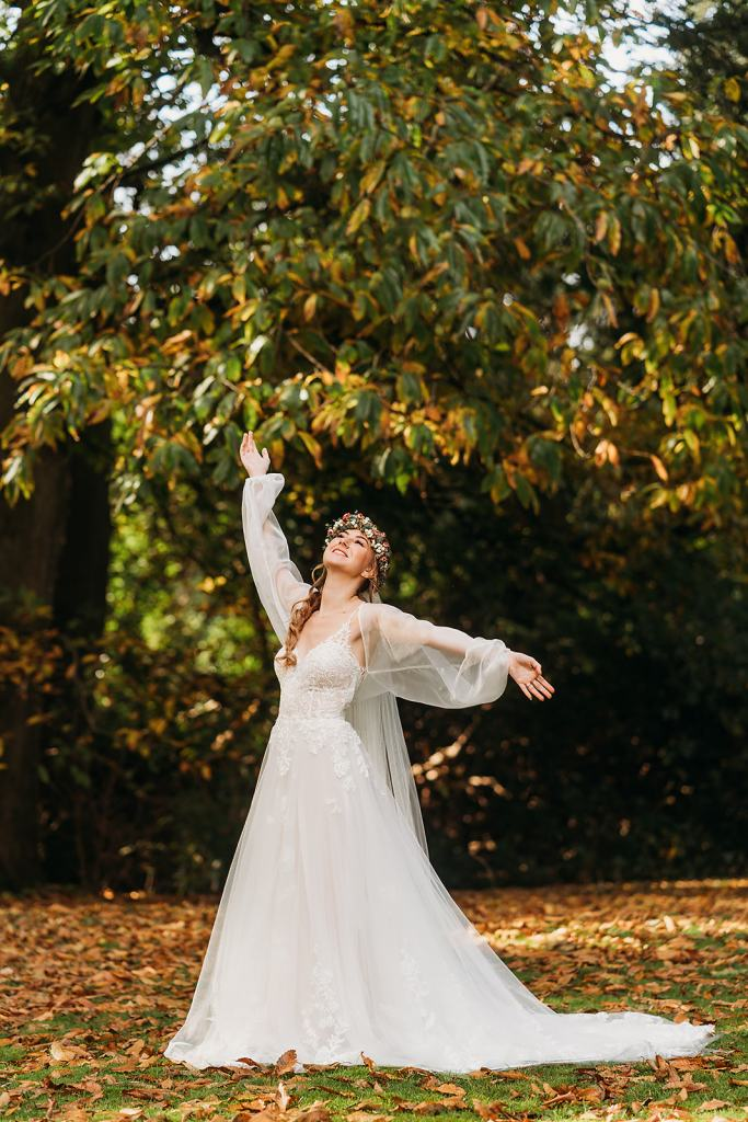 The Woodlands at Fillongley Hall - outdoor wedding ceremony location - bride with arms in the air