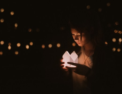 Girl holding memorial candle.