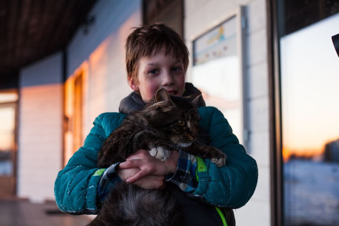 boy holding a cat