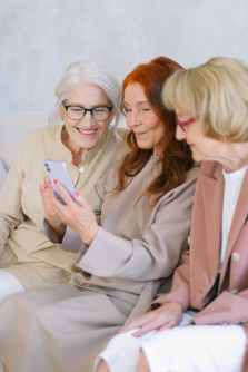 elderly happy women browsing internet while searching for information