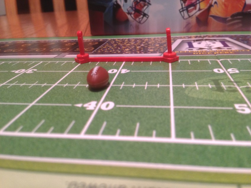 Closeup of football and down markers