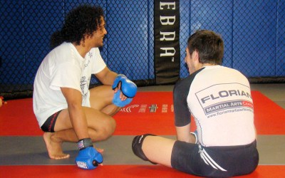 kenny florian and benson henderson resting after training
