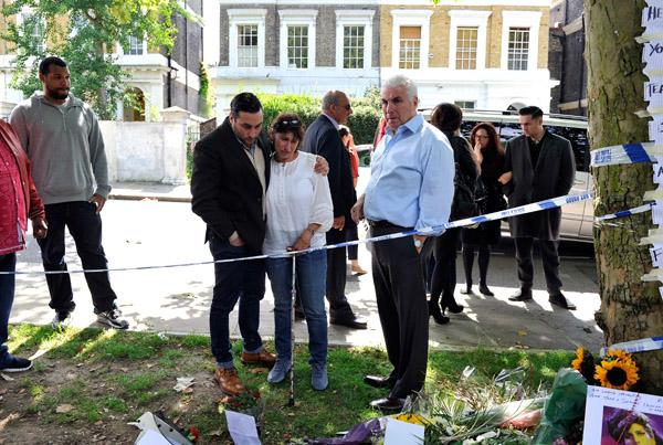 Amy Winehouses Parents Visit Memorial Site  That Grape Juice