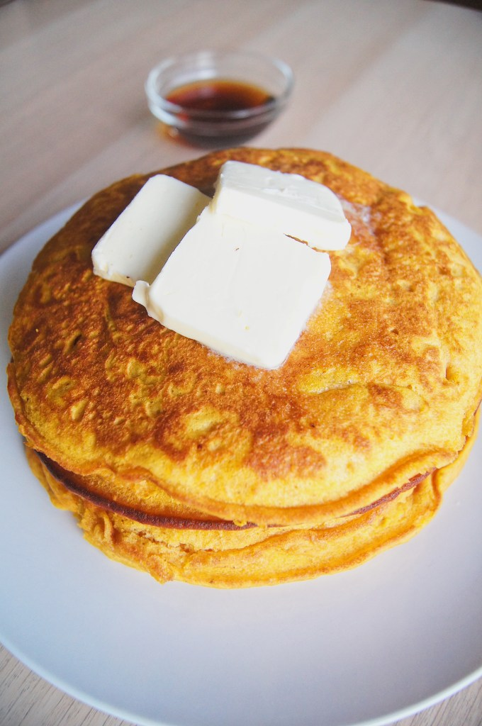 Pumpkin-pancakes-with-butter-on-top-and-syrup-on-the-side