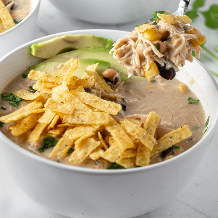 Crockpot White Chicken Chili with spoonful of chili