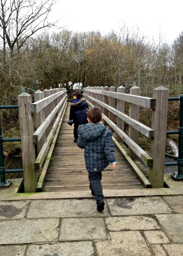 boys running on bridge