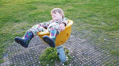 toddler in spinning chair