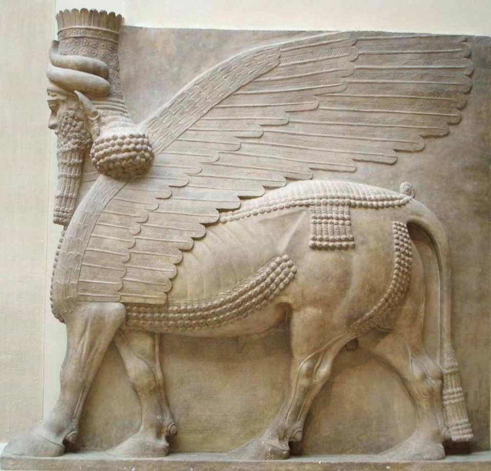 side view of Assyrian winged bull lamassu sculpture 7th Century BC, Louvre Paris