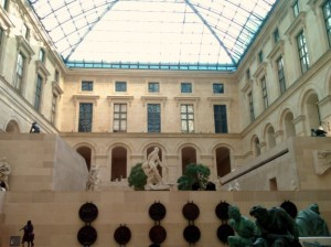 Louvre sculpture gallery with glass ceiling