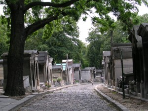 tree lined avenue of mausoleums in Père Lachaise cemetery Paris