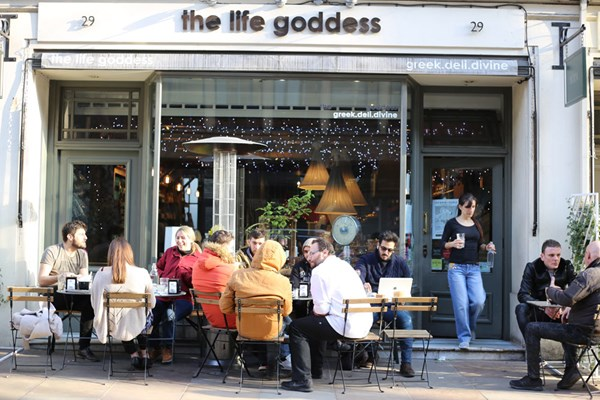 patrons eating outside the life goddess greek deli