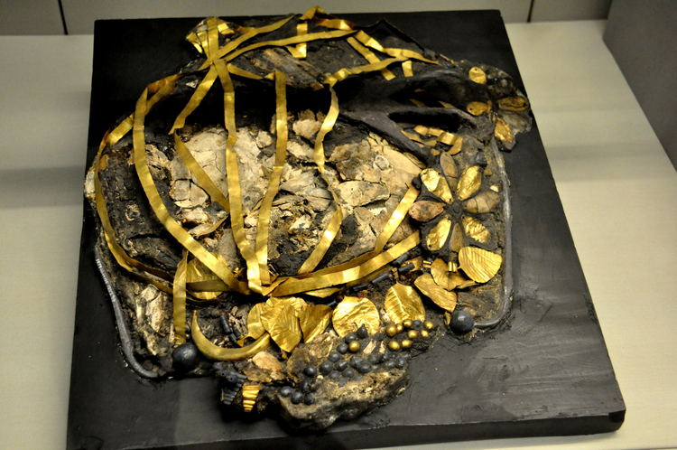 Crushed skull and remains of gold headdress in British Museum