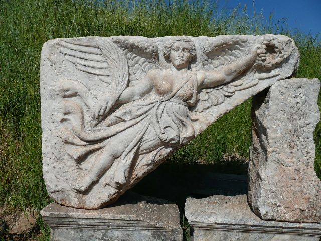 Stone carving of Nike, Greek Goddess of Victory, holding a wreath