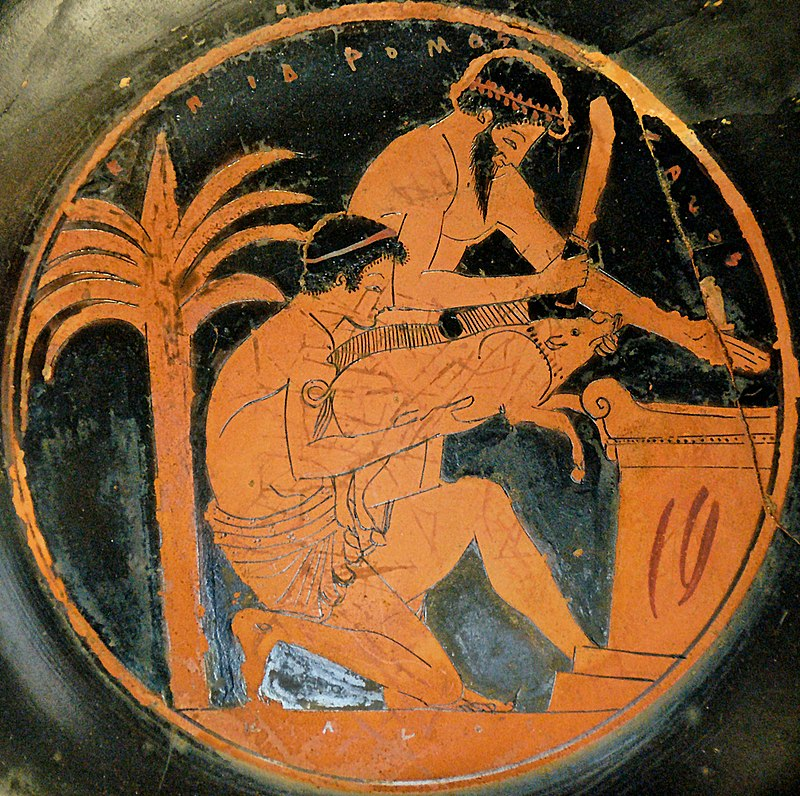 A Kylix (greek drinking vase) showing two men offering a boar at a sacrificial altar